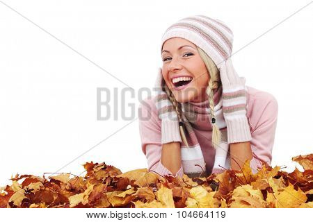 Beautiful woman with autumn leaves isolated on whiite background