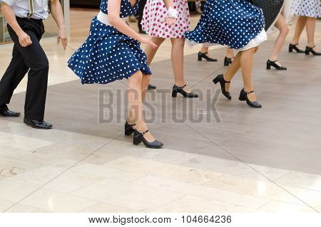Dance Group In Vintage Clothes Dancing On Marble Floor