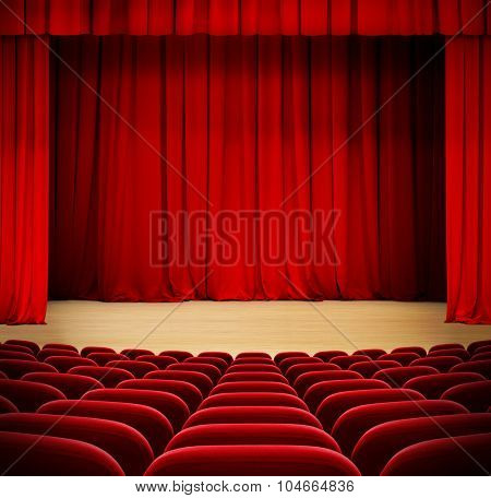 red curtain on theater wood stage with red velvet seats