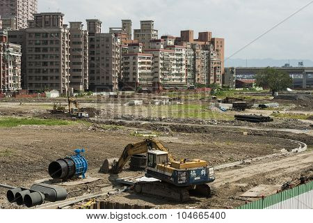 Taipei, Taiwan - September 29, 2013: a wrecking crane digs debris to make the area flat and get read