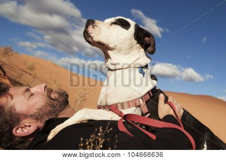 man and his loving pitbull