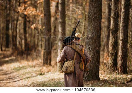 Unidentified re-enactor dressed as Soviet soldier machine gunner