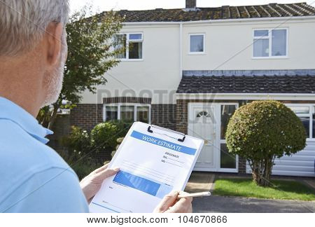 Builder Preparing Estimate For Exterior Home Improvement