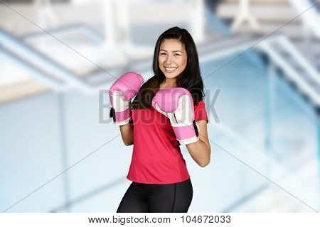 Woman working out while at the gym
