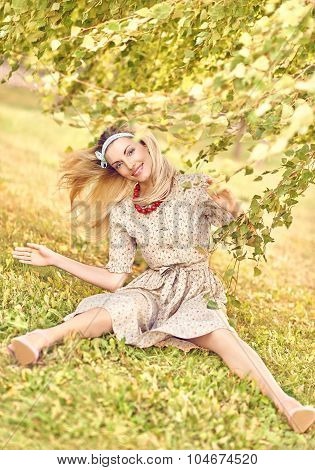 Beautiful playful woman under birch tree, outdoors, people