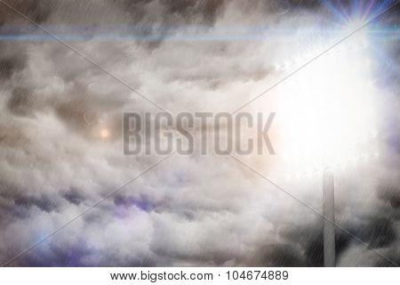 Spotlight against cloudy sky