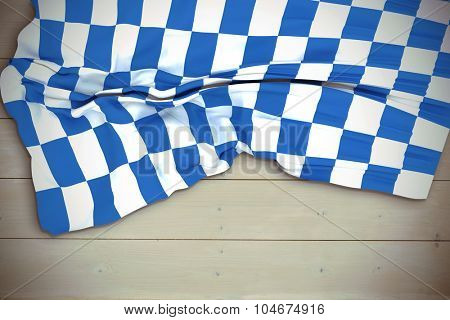 Blue and white flag against bleached wooden planks background
