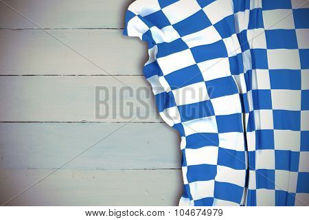Blue and white flag against painted blue wooden planks