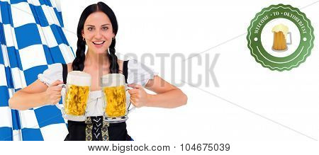 Pretty oktoberfest girl holding beer tankards against oktoberfest graphics