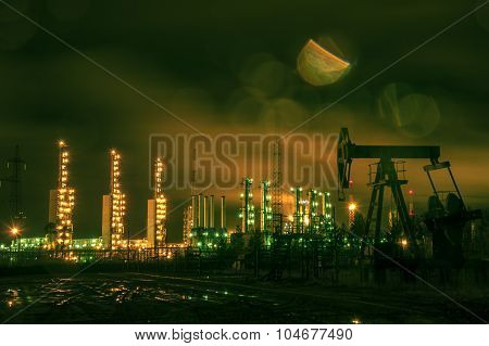 Pump Jack And Grangemouth Refinery At Night.