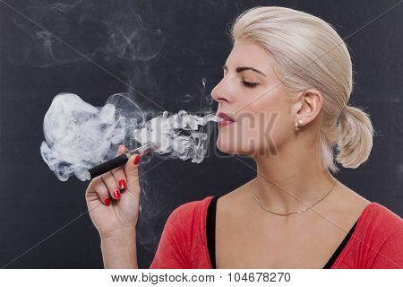 Stylish Blond Woman Smoking An E-cigarette