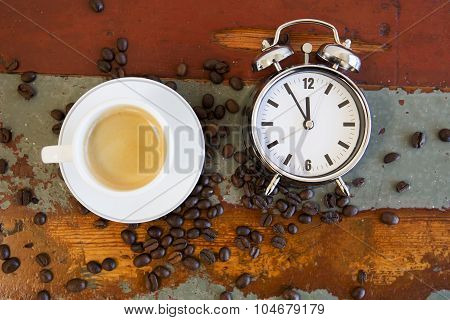 Coffee Beans And Cup Of Coffee And Alarm Clock