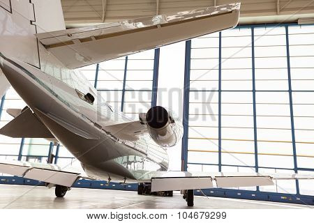Private Corporate Jet Parked In A Hangar