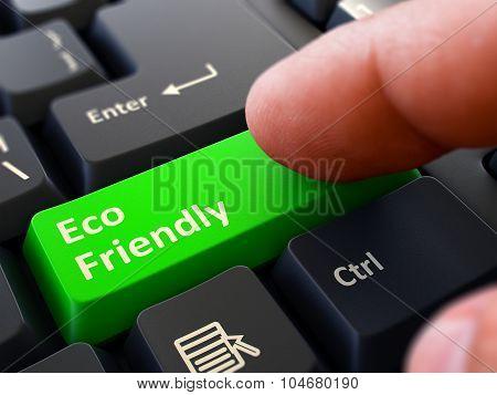 Pressing Green Button Eco Friendly on Black Keyboard.