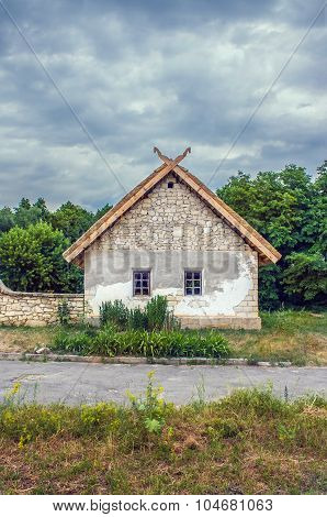 Ukrainian Stone House Under A Thatched Roof
