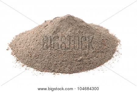 Pile of concrete sand mix isolated on white