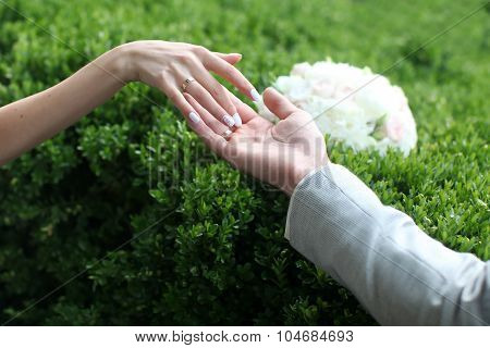 Human Hands And Wedding Flowers