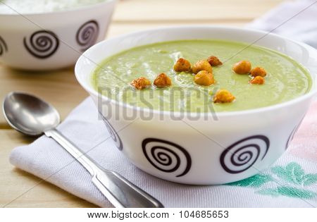 Green cream soup made of spinach, broccoli and peas