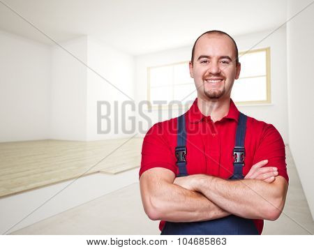 smiling handyman and house interior background
