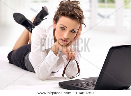 Young worried businesswoman with notebook