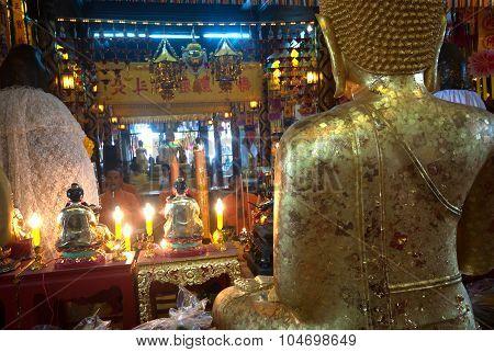 Back of golden sitting Buddha In Wat Phanan Choeng,Ayutthaya,Thailand.