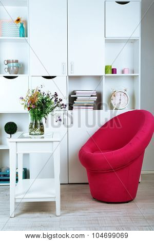 White living room with armchair and bookcase