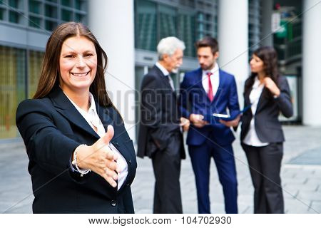 Beautiful Woman Shaking Hand With  The Background Of Business People