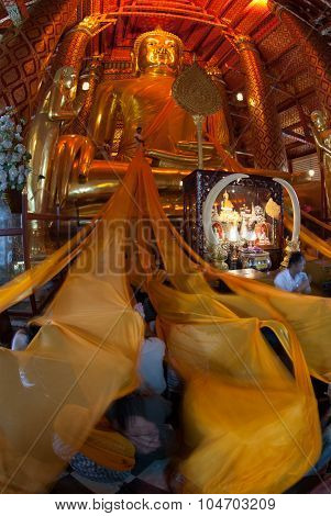The Thai Buddhist Peoples Are Yellow Rope Offerings For Luang Pho Tho In Wat Phanan Choeng,Thailand.