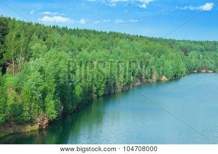 Landscape Of Beautiful Lake In Wood Open-cast Mine