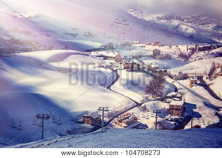 Air view on beautiful ski resort, mountain covered with snow, luxury little cottages and chalets, spending winter holidays in Lebanon