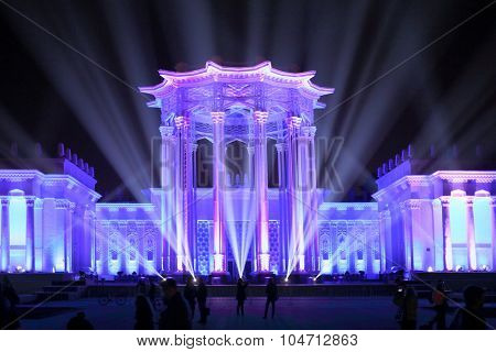 MOSCOW - OCT 10, 2014: Culture Pavilion at the Exhibition of Economic Achievements in blue rays of spotlights at the Festival Circle of Light in Moscow