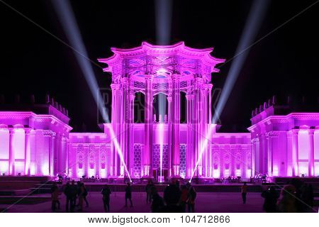 MOSCOW - OCT 10, 2014: Culture Pavilion at the Exhibition of Economic Achievements in pink rays of spotlights at the Festival Circle of Light in Moscow