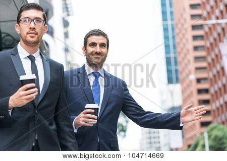 Businessmen catching taxi