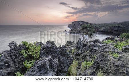 Sunset On Rocky Cliff