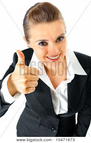 Smiling modern business female showing thumbs up gesture