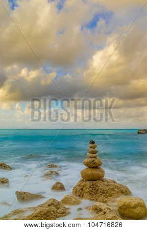 Stack of stones on the beach in Lefkada Greece