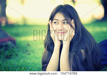 Asia Beautiful Smiling Woman Lying On Grass