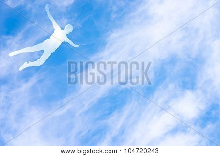 Human Silhouette In Flight Against The Sky