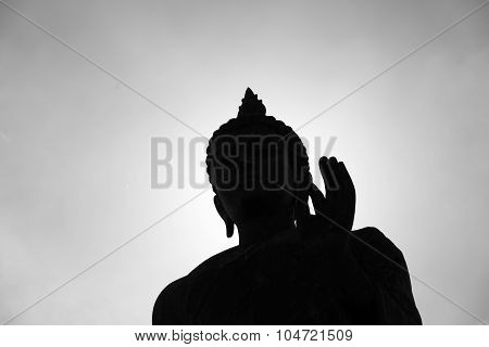 Buddha Statue With Dark Silhouette With White  Sunlight