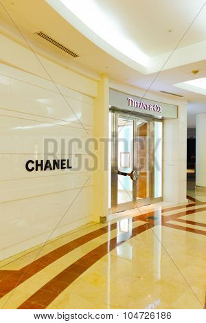 KUALA LUMPUR, MALAYSIA - APRIL 23, 2014: Tiffany&Co and Chanel stores exterior in Suria KLCC shopping mall. Suria KLCC is one of the largest shopping malls in Malaysia