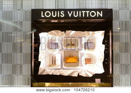 KUALA LUMPUR, MALAYSIA - APRIL 23, 2014: Louis Vuitton shop window in Suria KLCC shopping mall. Louis Vuitton or shortened to LV, is a French fashion house founded in 1854 by Louis Vuitton