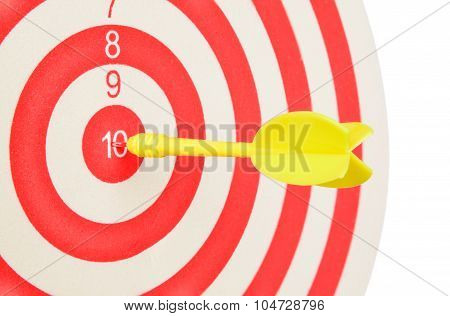 Dartboard With Yellow Dart At The Center Isolated On White