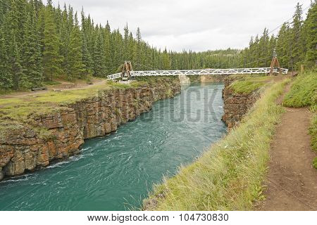 Footbridge Over A River Canyon