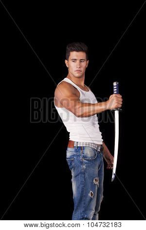 Young warrior holding a ninja sword (isolated on black)