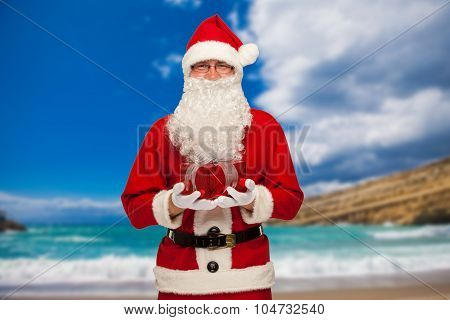 christmas, holidays, travel and people concept - man in costume of santa claus with gift box over tr