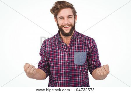 Portrait of successful hipster with clenched fist against white background