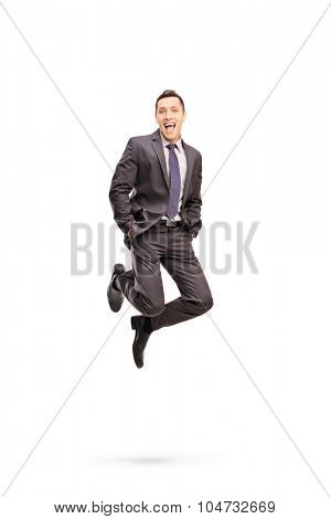 Full length portrait of a joyful businessman shot in mid-air while jumping out of happiness isolated on white background