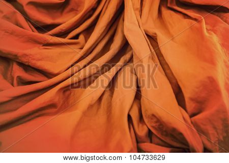 Orange Robe With Ripple  Of Thai Monk Closeup Background