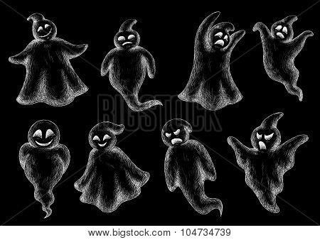 Set of Halloween ghosts on a blackboard