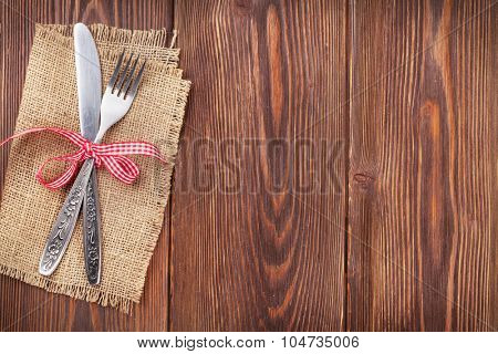 Christmas wooden background with silverware